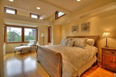 Traditional Master Bedroom with High ceiling, Hardwood floors