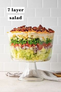 This 7 layer salad is a classic potluck and entertaining favorite, made even better with all the best layers! With lettuce, peas, tomatoes, cucumber, chopped eggs, and lots of bacon, cheese, and a heavenly creamy dressing, your guests will be fighting over the last of this make-ahead layered salad side! #salad #layered #bacon #easy Appetizer Recipes, Dessert Recipes, Appetizers, 7 Layer Salad, Vegan Cheddar Cheese, Healthy Recipes On A Budget, Healthy Alternatives, Paleo Recipes, Easy Recipes