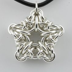 December weave star pendant by Kenth Kutschera.