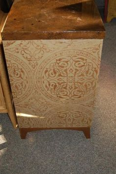 Don't throw away your old furniture, paint it with a stencil, Like Wallovers Gabriel's Gates shown here, and give it a completely new feel!