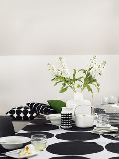 Marimekko Kivet White / Black Tablecloth Maija Isola's 1956 Kivet (Stones) pattern is set in it's classic black and white colorway atop a linen cloth. Perfect for use as a table linen but also suitable as a decorative bedding or wall tap. Marimekko, Scandinavian Design, Scandinavian Living, Black Tablecloth, Interior Decorating, Interior Design, Nordic Interior, Rustic Feel, Home