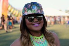Pin for Later: Spring Beauty Inspiration Straight From the California Desert Coachella Beauty Street Style 2015 Neon clothing and accessories got another vibrant boost from a vivid purple pout.