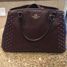 BURGENDY COACH PURSE AMAZING COACH MARGOT STUDDED CARRYALL. Like brand new burgendy coach purse. Used the purse maybe 5 times mint condition. I just don't use as much as I thought. Also have the dust bag and matching maroon wallet that I can bundle. No scratches or markings to wear and tear. Coach Bags
