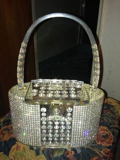Patricia of Miami rhinestone Lucite purse. I know this isn't jewelry, but look how this beautiful lucite purse is COVERED in rhinestones!! Arm candy for sure!!