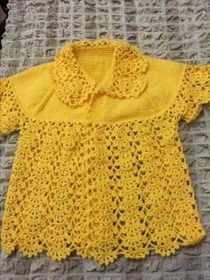 Hand crochet/crocheted dress for your special little girl. This dress also has a pearl button closure on the neckline, and This Pin was discovered by Pet This Pin was discovered by HUZ Another of those simply beauti Crochet Girls, Crochet For Kids, Hand Crochet, Knitting For Kids, Baby Knitting Patterns, Crochet Patterns, Girls Sweaters, Baby Sweaters, Crochet Blouse