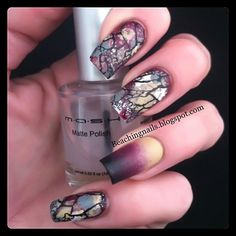 Italian Marble?  That's what they look like to me!  Beaching Nails has this as her Facebook profile pic. She commented that she just blotted on a few different colors, and then stamped on the black using Cheeky jumbo plate D.  It's a gorgeous combo!