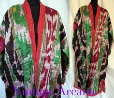 Vintage 1970's amazing kaftan coat made of beautiful hand woven Atlas ikat silk fabric in a rainbow of shades of green, dark red, yellow, black, blue, and silver Padded coat is lined with vivid rose print cotton and trimmed with machine embroidered red cotton. No fasteners, these coats are worn open or belted with a woven sash in colder weather. All handmade by Uzbek artisans. Beautiful!
