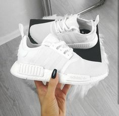 Top 10 Adidas NMD Sneakers The reign of Adidas NMDs is never ending as we always witness the release of a new NMD day after [. Nmd Sneakers, Best Sneakers, Sneakers Fashion, Adidas Sneakers, Adidas Shoes White, Adidas Shoes Women, Adidas Fashion, Nmd Adidas Women White, White Tennis Shoes
