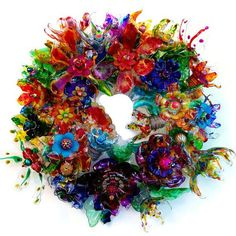 Plastic bottle flower door wreath, Recycled Art, Plastic Bottle Art Centerpiece, Art Statement, Abstract Colorful Wall Art CHihULy inspired plastic bottle flower wreath by ArtePlastique Plastic Bottle Flowers, Plastic Bottle Crafts, Plastic Art, Recycle Plastic Bottles, Plastic Recycling, Melted Plastic, Plastic Animals, Recycled Art Projects, Recycled Crafts