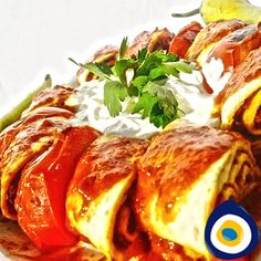 Beyti kebab is a Turkish dish consisting of ground beef or lamb, grilled on a skewer and served wrapped in lavash and topped with tomato sauce and yogurt.