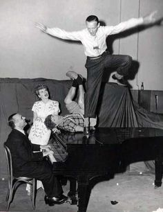 Jose Iturbi, Lucille Ball, Harpo Marx and Fred Astaire rehearsing the routine they will put on for troops during the WWII USO tour.