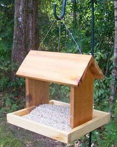 Image from http://www.start-with-free-woodworking-plans.com/images/FeederHangingFood.jpg.