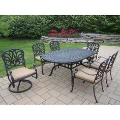 Hampton 7 Piece Dining Set with Cushion by Oakland Living. $2690.99. Hardened Powder Coat Finish in Antique Bronze for Years of Beauty. Easy to Follow Assembly Instructions and Product Care Information. Rust Free Aluminum Construction. Fade, Chip and Crack Resistant. Galvanized Assembly Hardware. 7214-7201-7202-13-D56-AB Features: -Fade, chip and crack resistant. Includes: -Set includes 1 dining table, 4 fully welded dining chairs with cushions, 2 swivel rocki...