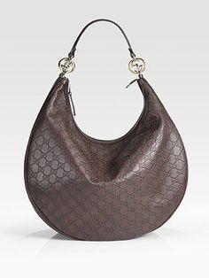 and hobos too,,oh who am I kidding...I love ALL handbags;-)