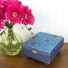 An old-fashioned cigar box is upcycled into a flowery treasure box with the help of Americana Mixed Media Stencils and Glamour Dust Glitter Paints.