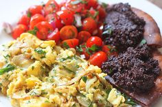 Scrambled Eggs with Gruyère, Fried Pita with Olive Tapenade & Tomato Salad.