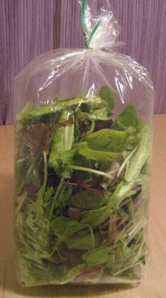 How To Store Salad Greens so they keep longer: blow into the bag and seal it tightly. The carbon dioxide helps keep the greens fresh longer. Also works for herbs. Who knew?