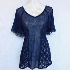 Free People // Perfect Festival Top in Lace - navy Navy color, lightweight material with floral lace details. Has ties in the back to add shape, flutter sleeves. Never been worn, NWOT!   *offers welcome* Free People Tops