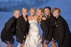 Winter Wedding shot with bridesmaids and their groomsman's jackets!