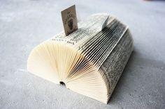 Transform a vintage book into an artful business card holder.