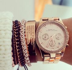 layered bracelets and watch