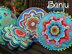 Love these cushions--a great mix of crochet, sewing and embroidery.
