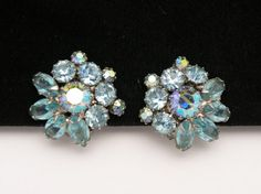 Beautiful vintage Weiss earrings with blue and aurora borealis rhinestones set in silver tone plated mountings.