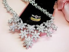Bridal Jewelry Trend - Fleurir Statement Necklace, Stacking Trio Rings and Solitaire Ring.