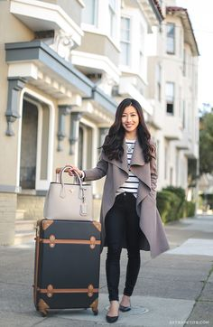 casual travel outfit // drape wrap jacket, stripe tee, black jeans, flat, trunk luggage - all outfit info on the blog!