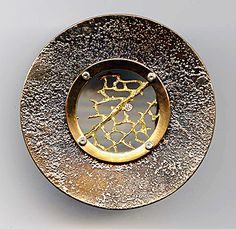 "Andy Cooperman - Mona Belt Buckle. 18K Gold, Sterling Silver & Bronze with Diamonds. Seattle, Washington. Circa Early-21st Century. 2-1/4"" x 3/4""."