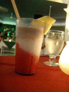 A Jamaican Smile drink at Couples Tower Isle, Jamaica. 1/2 Strawberry Daiquiri, 1/2 Pina Colada and a shot of Rum Cream on top. Heaven!