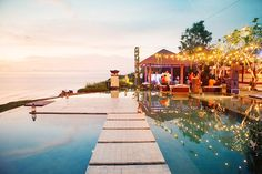 Bali wedding with gorgeous stone path over water and lots of flowers