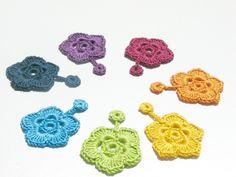 Rainbow crochet flowers / garland or greetings tag / bright colors / shiny cotton. $15.00, via Etsy.