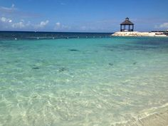 The beach at Secrets Wild Orchid Montego  Bay Jamaica. The dark area in the center is a sting ray.
