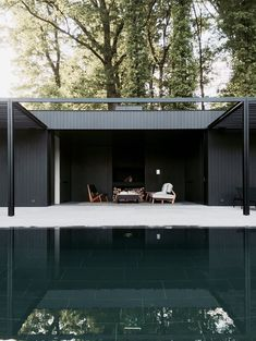 The CD Pool House is a simple yet elegant space. The structure's defining feature is its sleek, dark façade. Stretches of straight timber merge with black-framed glass and a metal trellis. The darkened wood continues throughout the...