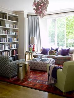 eclectic living room - mismatched neutral furniture, bold rug