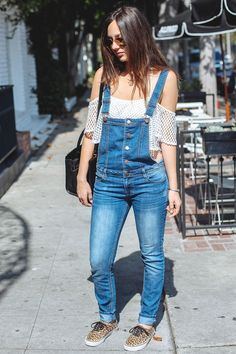 Chic! 8 Perfect Outfits Spotted On Melrose #refinery29 http://www.refinery29.com/melrose-avenue-fashion#slide-7 Who: Nineeve Draghici Wearing: Nasty Gal top, vintage overalls, Vans shoes, Zac Posen bag.