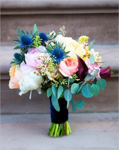 Leafy green and bright floral bouquet by Full Aperture Floral. #wchappyhour #weddingchicks http://www.weddingchicks.com/2014/07/14/wedding-chicks-happy-hour-27/