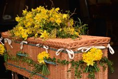 A willow coffin decorated with spring flowers by Matthew Spriggs. Call us on 01798 343372 if you would like to discuss flowers for your loved one. Funeral Flowers, Wedding Flowers, Casket Sprays, Funeral Tributes, Funeral Arrangements, Sympathy Flowers, Seasonal Flowers, Spring Flowers, Coffin