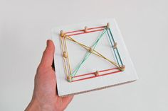 Make your own geo board from pegs, cardboard, and glue.
