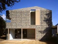 Gabion rock cage home by Titus Bernhard Architeckten - metal cage filled with rocks. http://www.treehugger.com/sustainable-product-design/konzept-haus-9x9-by-titus-bernhard-architekten.html