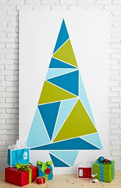 If you're short on space or want to double your decorations, a mosaic wall tree is a festive solution. For this painted color-block Christmas tree, choose colors that complement your decor.