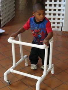 Plan on getting or making a standing/walking frame for C so that she can practice standing up & sitting down. Site doesn't give PVC directions.