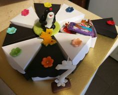 Funny paper cake filled with chocolates
