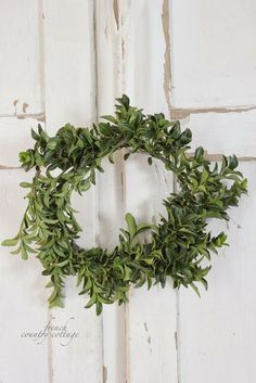 FRENCH COUNTRY COTTAGE: 5 minute wreath- DIY - two branches of boxwood, loosely loop wire around the length and connect to next branch.  Forming a horseshoe shape, then wire ends to form circle.  Then if u want, wire in more boxwood to fill in.