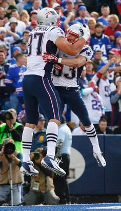 New England Patriots' Rob Gronkowski (87) celebrates his touchdown with Wes Welker (83) against the Buffalo Bills during the second half of an NFL football game in Orchard Park, N.Y., Sunday, Sept. 30, 2012