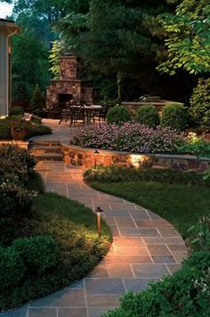 Installation of Custom Blue Stone or Flagstone Walkway and Custom Block Retaining Walls with Low Voltage Lighting from Driveway to the Rear Back Patio and Fire Place Pit.. Call Today, an ask for Gerard @ 973-477-3345 to Schedule an Appointment for a Free Quote on any Installation of Various Style's and Colors for your Rear Walkway, Steps, Retaining Walls, Fire Pit and Lighting. www.gspropmgmt.com
