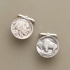 "VINTAGE BUFFALO NICKEL CUFF LINKS -- On the cuff, the all-American Buffalo-Head nickel adds panache to the workaday wardrobe. Featuring coins minted between 1913 and 1938. Backed in sterling silver and accompanied by a certificate of authenticity. 3/4"" Dia."