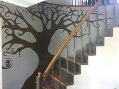 hand painted tree mural along curved wall of our curved staircase.