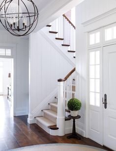 Foyer light----Interior: Hollywood-inspired country getaway - Style At Home I love how the stairs can't be seen from the front door! Villa Plan, Interior And Exterior, Interior Design, Interior Trim, Interior Styling, Foyer Lighting, Entryway Chandelier, House Lighting, Entry Hallway